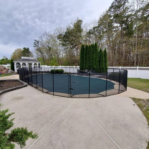 black mesh pool fence installed in Bayville, NJ